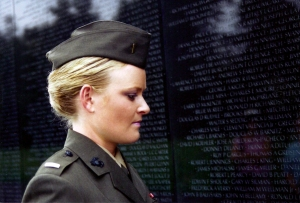Lieut. Elle Helmer, U.S. Marine Corps., visits the Vietnam War Memorial in THE INVISIBLE WAR, a Cinedigm/Docurama Films release.
