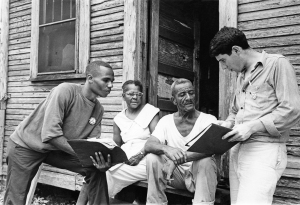Volunteers  Johnny Waters, Ceola Wallace and Jake Plum explain voter registration procedures to Willie McGee.  Photo:  Johnson Publishing Company LLC.
