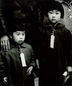 Japanese-Americans were tagged en route to internment camps in 1942. Photo: Dorothea Lange © 1942.