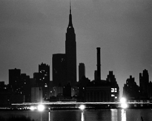 The  NYC skyline from Queens during the power blackout of 1977.  Lights glow in a midtown Waterside Con Ed plant as traffic passes on East Side Drive. Photo: Dan Farrell/NY Daily News via Getty Images.