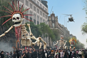 The chase is on during the Day of the Dead parade in Mexico City. Metro-Goldwyn-Mayer Pictures/Columbia Pictures/EON Productions' action adventure SPECTRE.