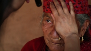 Nepali farmer Manisara, and her husband of 50 years, have their eyesight restored via free cataract surgery documented in OPEN YOUR EYES. Photo courtesy HBO.