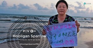 In May 2013, women's rights activisit Ye Haiyan held up a sign at a protest against an elementary school principal and a government official accused of raping six female students, ages 11 to 14, in Wanning City, Hainan Province, China. The backstory is documented in HOOLIGAN SPARROW on PBS. Photo courtesy POV Digital.