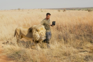 Animal Behaviorist Kevin Richardson discusses his remarkable bonding rituals with a pride of lions in the Kevin Richardson Sanctuary in South Africa. As seen in NATURE: THE STORY OF CATS. Photo: Anwar Mamon/Plimsoll Productions.