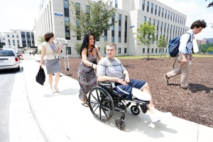 JP Norden, a Boston Marathon bombing survivor, visits his doctors and amputees who served in the U.S. military at Walter Reed National Military Medical Center. He and his brother, Paul, were both badly injured but survived the Boston Marathon bombing. Photo: Yoon S. Byun/The Boston Globe. Photo courtesy HBO.