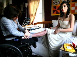 18-year-old Sydney Corcoran, a victim of the Boston Marathon bombing, preps for her Lowell (Mass.) Senior Prom. Her mom, Celeste, who lost both her legs in the bombing, changes the bandages on her daughter's injured foot. Photo: John Tlumacki/The Boston Globe. Courtesy HBO.