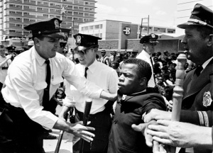 Metro policemen grabbed John Lewis, one of the leaders of the Civil Rights demonstrators, at Morrison's Cafeteria in Nashville on April 29, 1964. Lewis was the first of many to be arrested by the police. Photo courtesy The Tennessean.