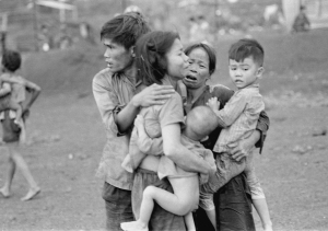 Civilians huddle together after an attack by South Vietnamese forces, Dong Xoai, June 1965. Photo courtesy AP/Horst Fass.