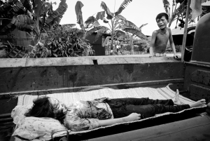 This 12-year-old girl was killed in the May Offensive (Mini-Tet) in Saigon, 1968. The Saigon fire department had the job of collecting the dead from the streets during the Tet offensive. They had just placed this child, killed by U.S. helicopter fire, in the back of their truck, where her distraught brother found her. When <em>The New York Times</em> published this photograph, it implied there was no proof that she was killed by American firepower. Photo courtesy Philip Jones Griffith/Magnum Photos.