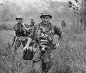 Horst Faas, Associated Press Chief of photo operations, with his Leica cameras around his neck, accompanied U.S. troops in War Zone C, Vietnam, circa 1967. Photo courtesy AP/Horst Faas.