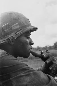 A soldier in the 25th Infantry Division, Vietnam, circa 1969. A disproportionate number of African-Americans were drafted, shipped overseas and ended up as casualties during the Vietnam War. Photo courtesy Charles O. Haughey.