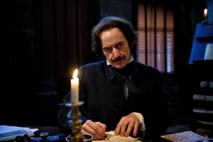 Edgar Allan Poe (Denis O'Hare) takes pen to hand on AMERICAN MASTERS. Photo: Liane Brandon.