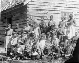A group of freed slaves with books, from TELL THEM WE ARE RISING: THE STORY OF BLACK COLLEGES AND UNIVERSITIES. Photo courtesy Cook Collection/The Valentine.