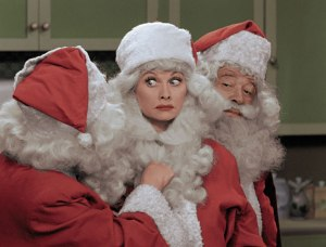 Who's the guy with the beard? Lucy and Santa share the spotlight in the annual I LOVE LUCY CHRISTMAS SPECIAL broadcast on CBS. Photo ©2017 CBS Broadcasting, Inc. All Rights Reserved.