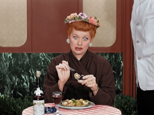 In PARIS AT LAST!, the newly colorized, 1956 episode of the I LOVE LUCY SHOW, Lucy Ricardo (Lucille Ball) dials down her passion for Paris when forced to swallow a plate of snails and pay for the privilege with a wad of counterfeit cash. Photo: CBS ©2019 CBS Broadcasting, Inc. All Rights Reserved.