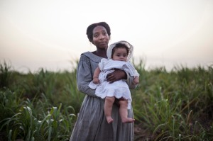 July (Tamara Lawrance) must walk a fine line to protect her daughter Emily in THE LONG SONG on PBS MASTERPIECE. Photo: Carlos Rodriguez © Heyday Television.