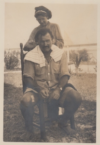 Ernest Hemingway's second wife, Pauline Pfeiffer, cutting his hair.
